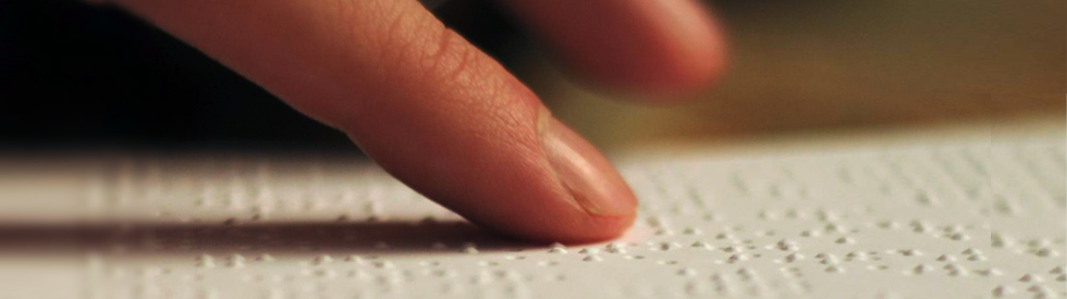 closeup of finger on braille
