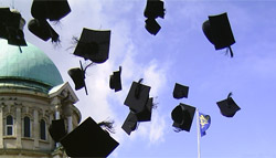mortar boards in air